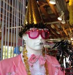 Mannequin wearing PartyLab paper hat.